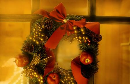 Christmas wreath on window,long exposure photo
