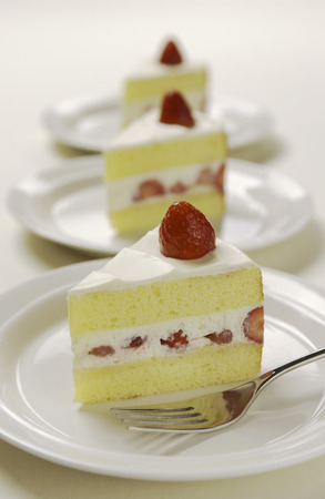 Plates of sliced strawberry cakes,white background photo