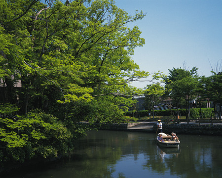 punting: People punting on a river in Yanagawa,Fukuoka Prefecture,Japan