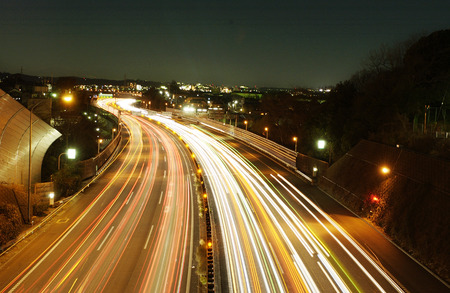 honshu: Long exposure of busy highway at night. Kanagawa Prefecture,Honshu,Japan Stock Photo