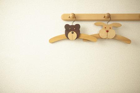 coathangers: Childs coathangers with animal faces hanging on coat hooks