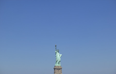 female likeness: Statue of Liberty against clear blue sky. New York,USA