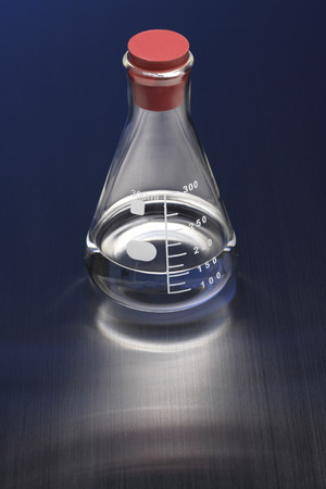 conical: Liquid in conical flask,black background Stock Photo