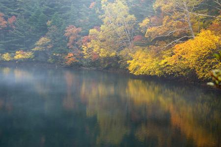 fukushima: Autumn foliage reflected in lake,Fukushima Prefecture,Japan Stock Photo