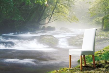 out of context: Chair by a flowing river