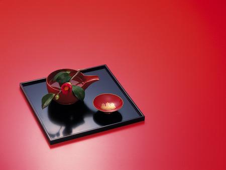 saki: Saki cup on tray Stock Photo