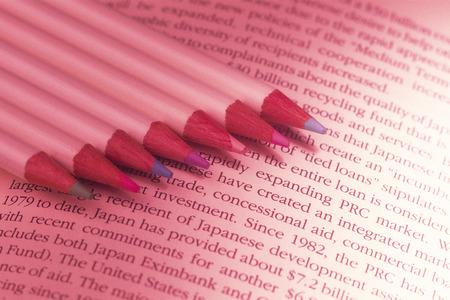 toned image: Pencils on books,close up,toned image