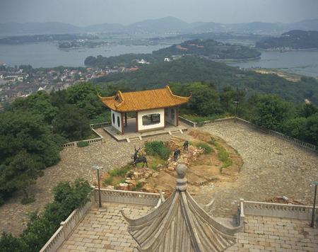 jiangsu: Lookout Over a City and a Lake. Jiangsu Province,China Stock Photo