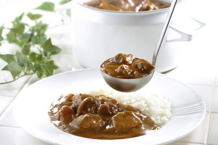 beef curry: A plate of white rice and beef curry Stock Photo