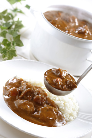 beef curry: A plate of white rice,beef curry and beef pot