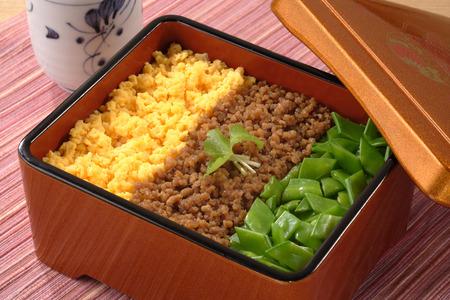 sanshoku: Sanshoku bento with three different toppings on rice