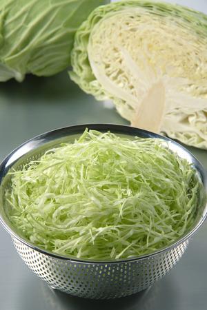 julienne: Julienne cut cabbage in a colander