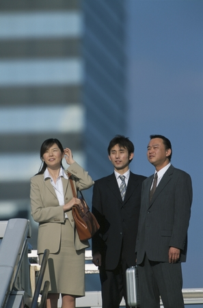 mannen en vrouwen: 3 Japanese business men & women Stockfoto