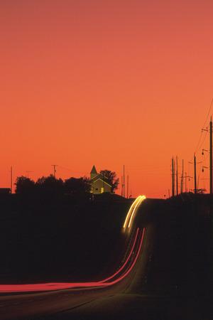 sloping: Sloping road at sunset