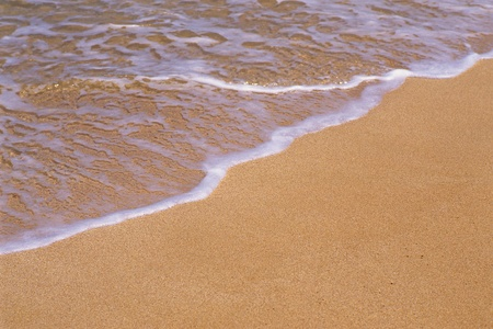 wavelet: Small waves and the beach Stock Photo