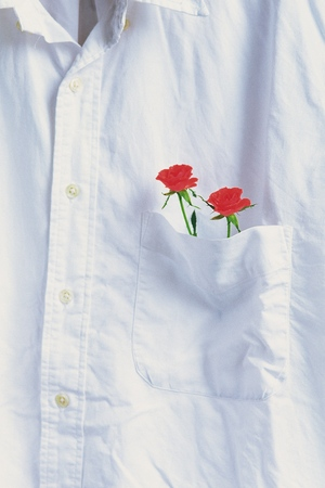 breast pocket: Red flower which was in the breast pocket Stock Photo
