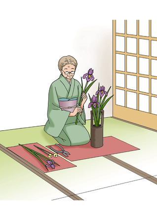 arranging: Woman arranging flowers Stock Photo
