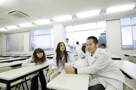 schoolmate: Asian college students in a classroom