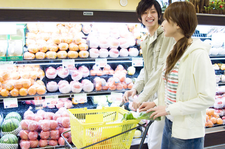grocery shopping cart: Asian college students at a supermarket