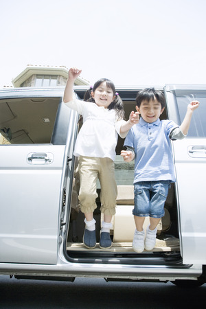 japanese children: Japanese children jumping out of a car