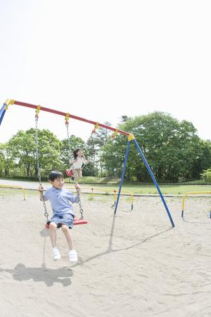 japanese children: Japanese children playing on swings