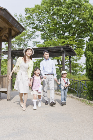 Japanese family at a park Stock Photo