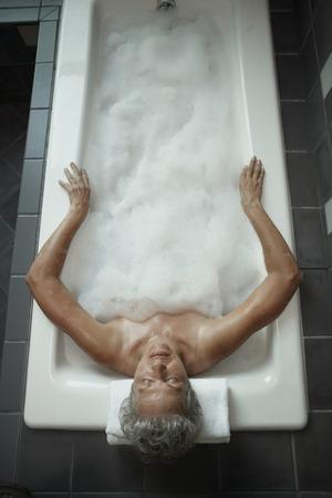 woman in bath: Caucasian woman in bath tub
