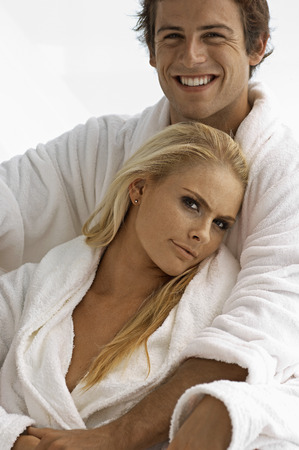 robes: Caucasian couple in bath robes
