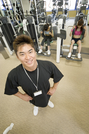 women working out: Fitness instructor with women working out in the gym Stock Photo