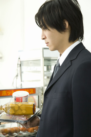 young man: Young man buying food Stock Photo
