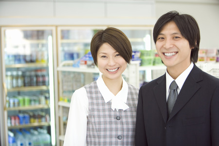 young man: Young man and woman smiling Stock Photo