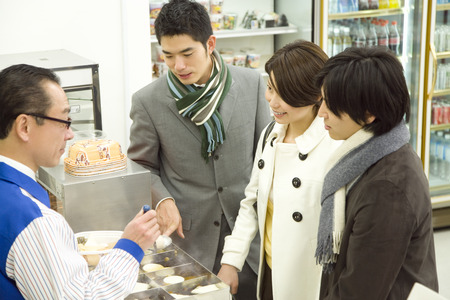 four person only: Customers paying for their items