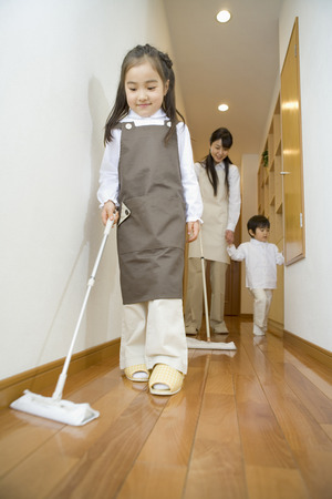 mops: Asian mother and children cleaning house