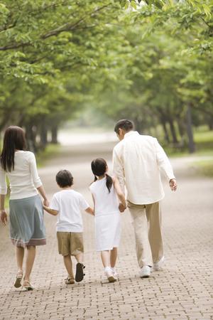 Asian family walking in park
