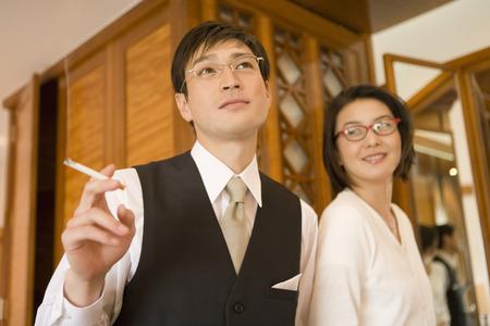 hombre fumando: Asian man smoking Foto de archivo