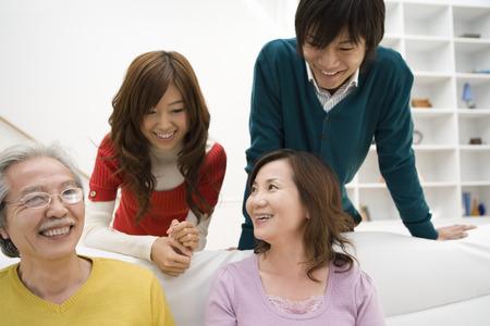 family  room: Asian family in living room Stock Photo