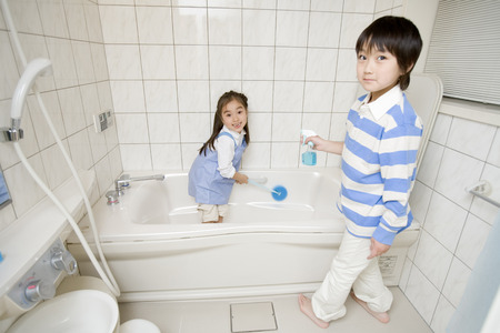 bathroom: Asian kids cleaning bathroom