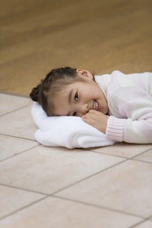 girl lying down: Asian girl lying down on towel