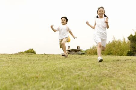 Asian children running outdoors Stock Photo