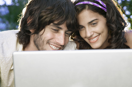 two people only: Young couple using laptop together