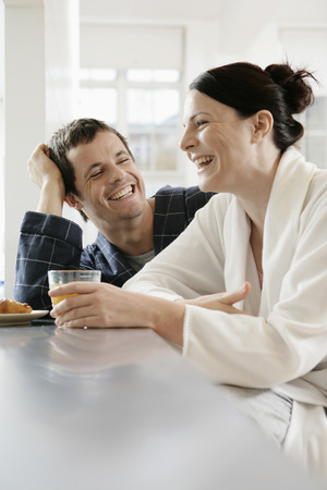 two people only: Mid adult couple in sleeping robe laughing