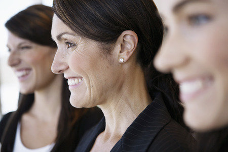 three people only: Close-up of businesswomen smiling with selective focus