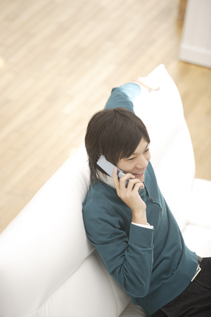 young man: Young man talking on mobile phone Stock Photo