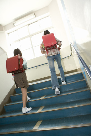 upstairs: Two school girls walking upstairs