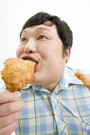 japanese ethnicity: Man eating fried chicken
