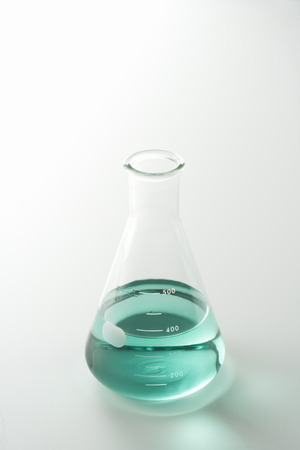 conical: Laboratory conical flask with blue liquid Stock Photo