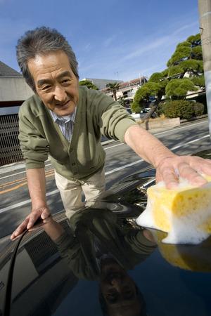 washing car: Senior man washing car