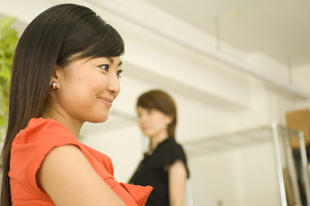 japanese ethnicity: Side view of two businesswomen in the office Stock Photo