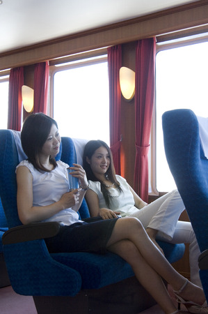 japanese ethnicity: Women relaxing inside the cruise ship Stock Photo