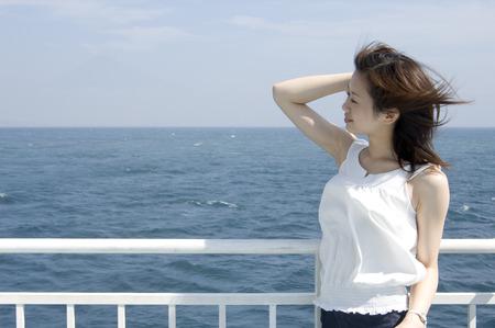 breeze: Woman enjoying the sea breeze Stock Photo